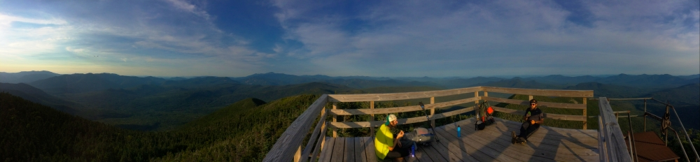 Andrew (left) and Michael (right) take a break on top of the fire tower before setting up camp on the summit.