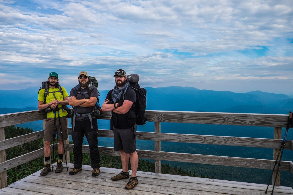 Andrew Golenski (left), Michael Arestad (middle), and myself on top of the fire tower before descending Mt. Carrigain in the morning