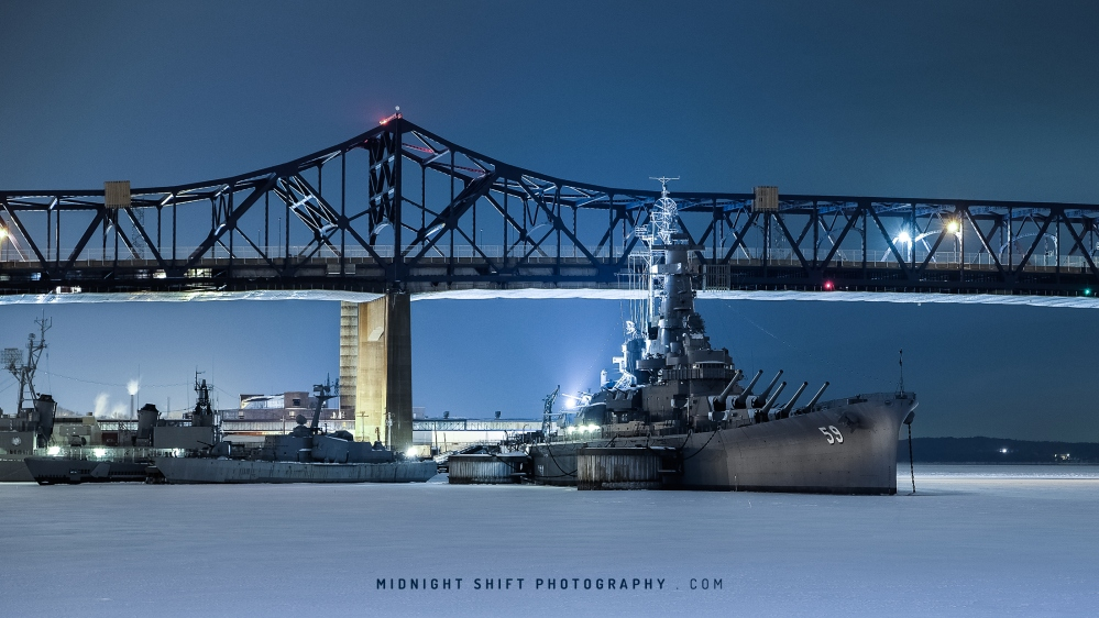The USS Massachusetts sits stuck in a sheet of ice at Battleship Cove, in Fall River, Massachusetts.
